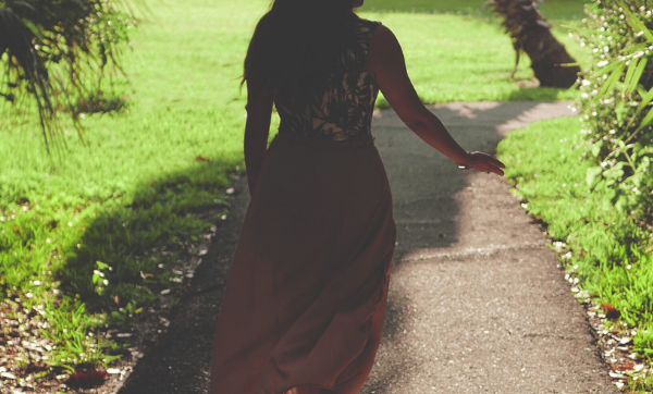 girl walking down path
