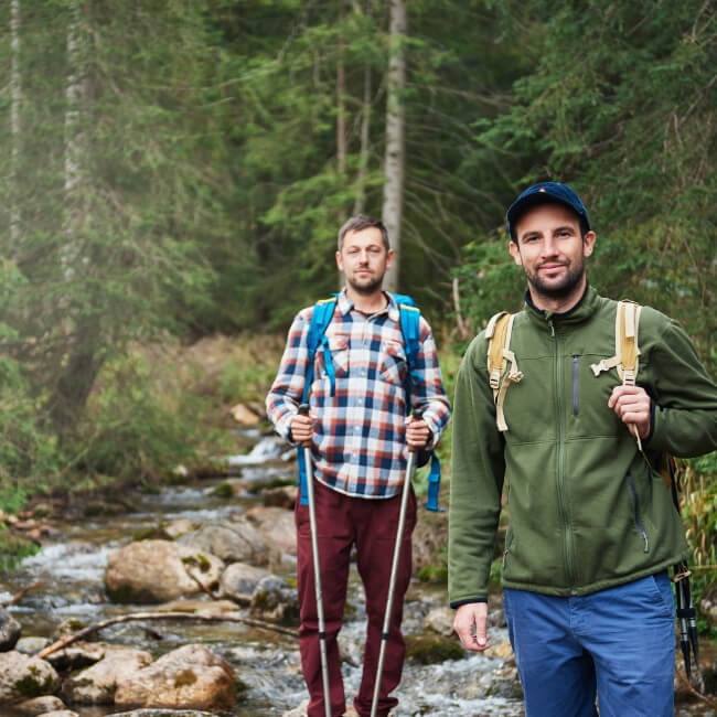 two male friends hiking