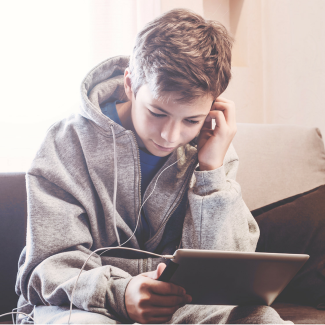 middle school boy on computer