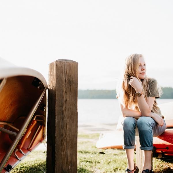 woman sitting on a canoe