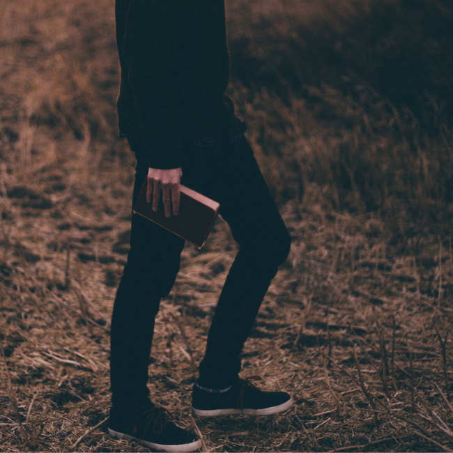 man walking with bible