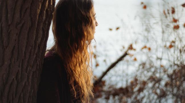 teen girl looking at lake