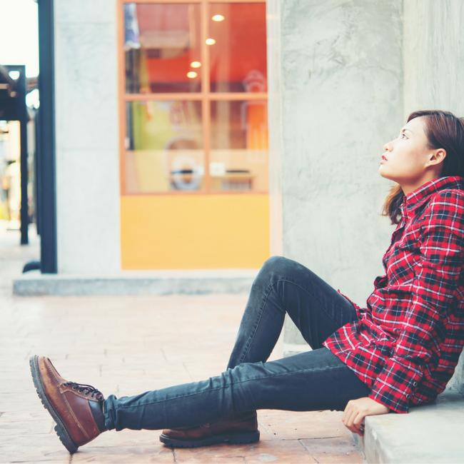upset woman sitting outside