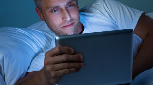 MAN ON COMPUTER AT NIGHT