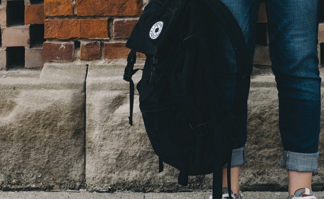 high school girl with backpack