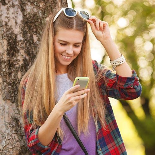 teen-girl-looking-at-phone