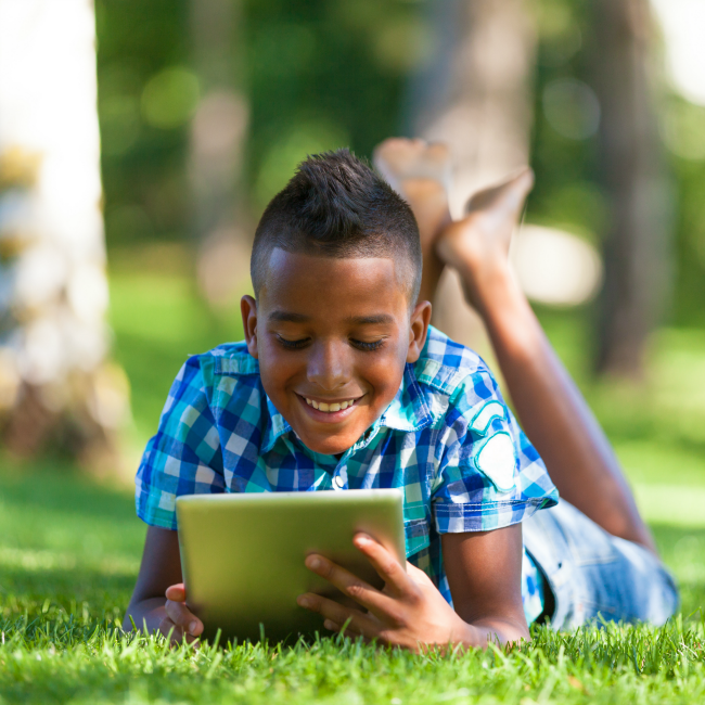 smart kid using tech