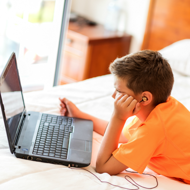young boy watching computer