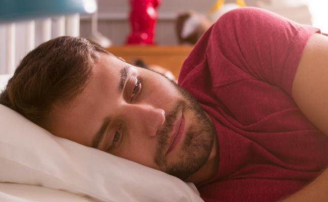 sad man in bed