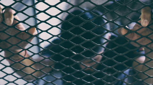 man in cage