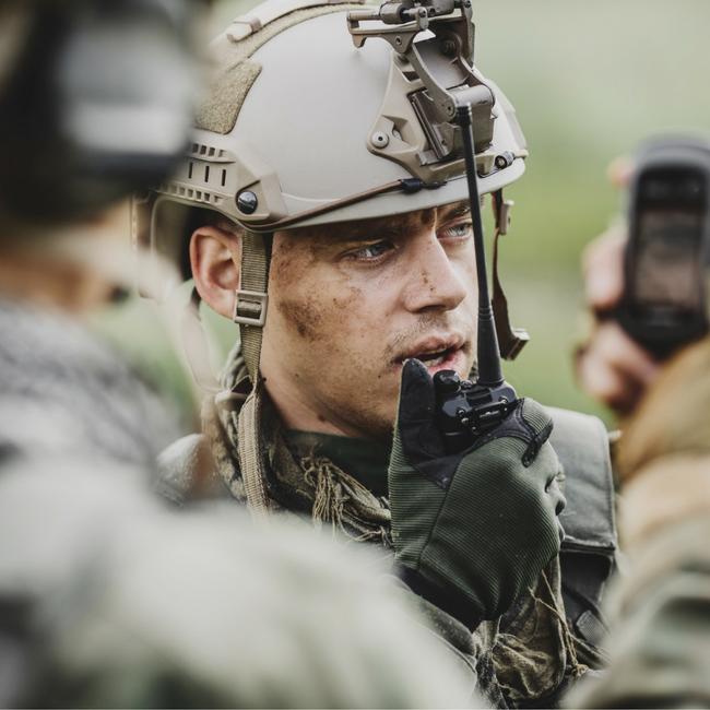 soldier communicating on radio