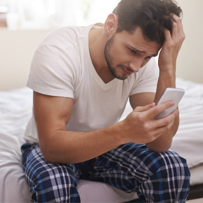 discouraged man looking at phone