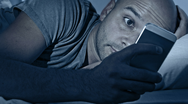 man on mobile phone at night