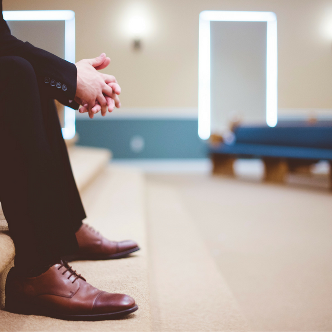 pastor sitting on stairs