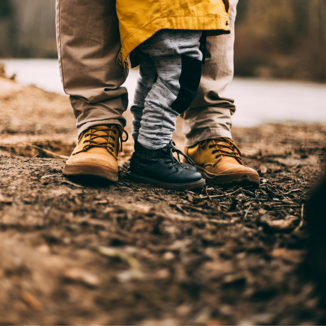 dad and child outdoors legs