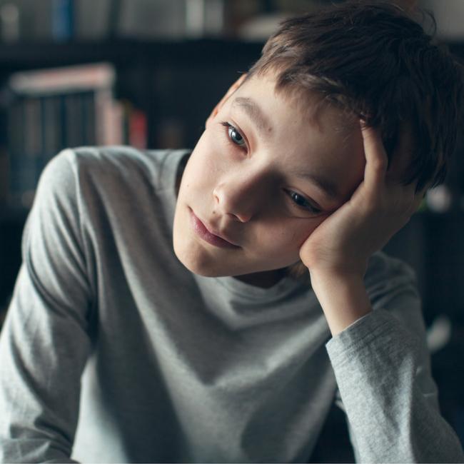 sad looking pre-teen boy