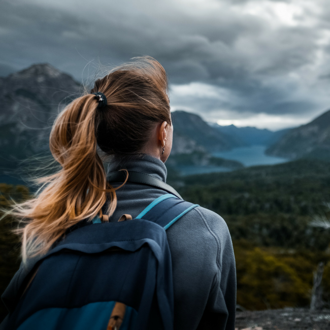 woman overlooking mountain river
