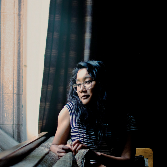 asian woman looking out window