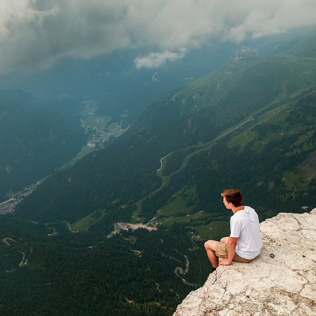 man overlooking cliff