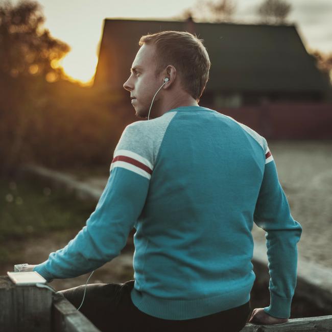man watching sunset at a farm