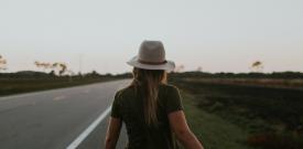 woman walking down empty road