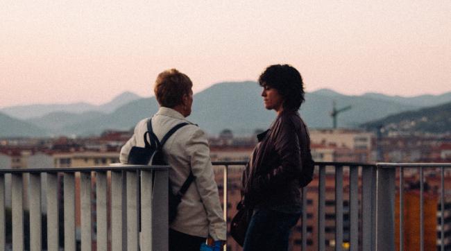 two women talking outside