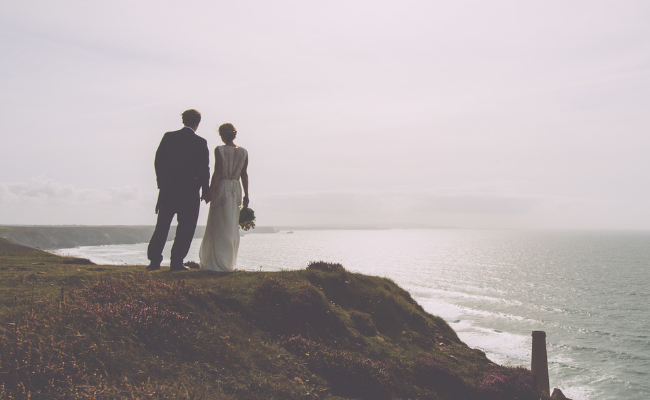 married couple overlooking cliff