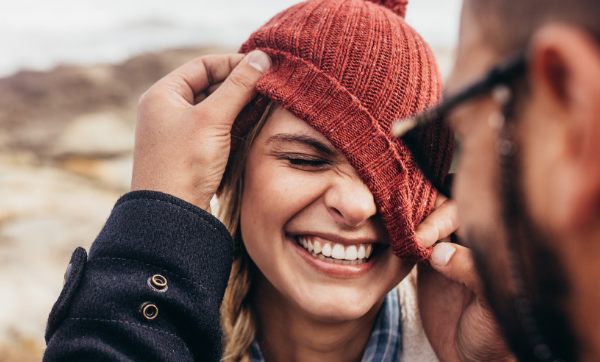 woman smiling with beanie hat