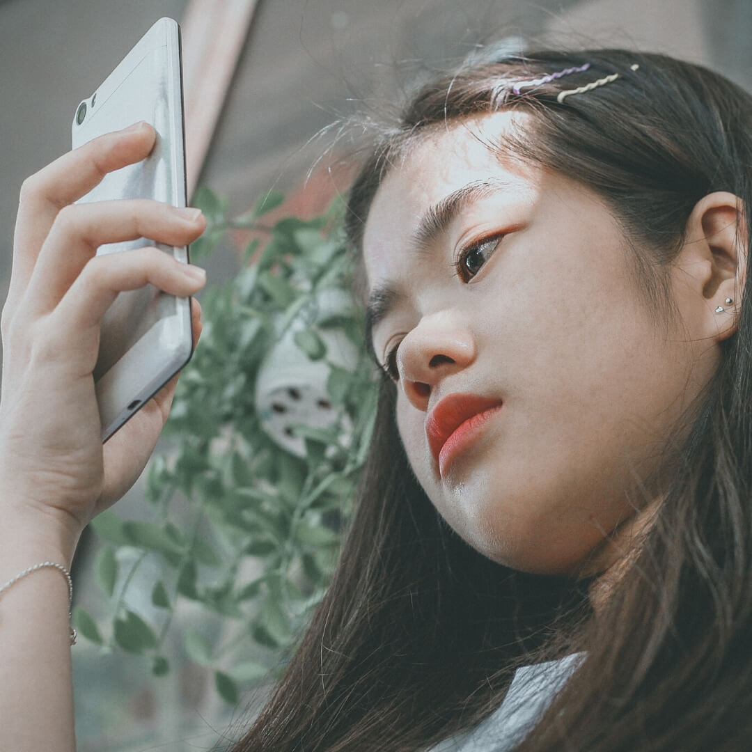 young girl looking at phone
